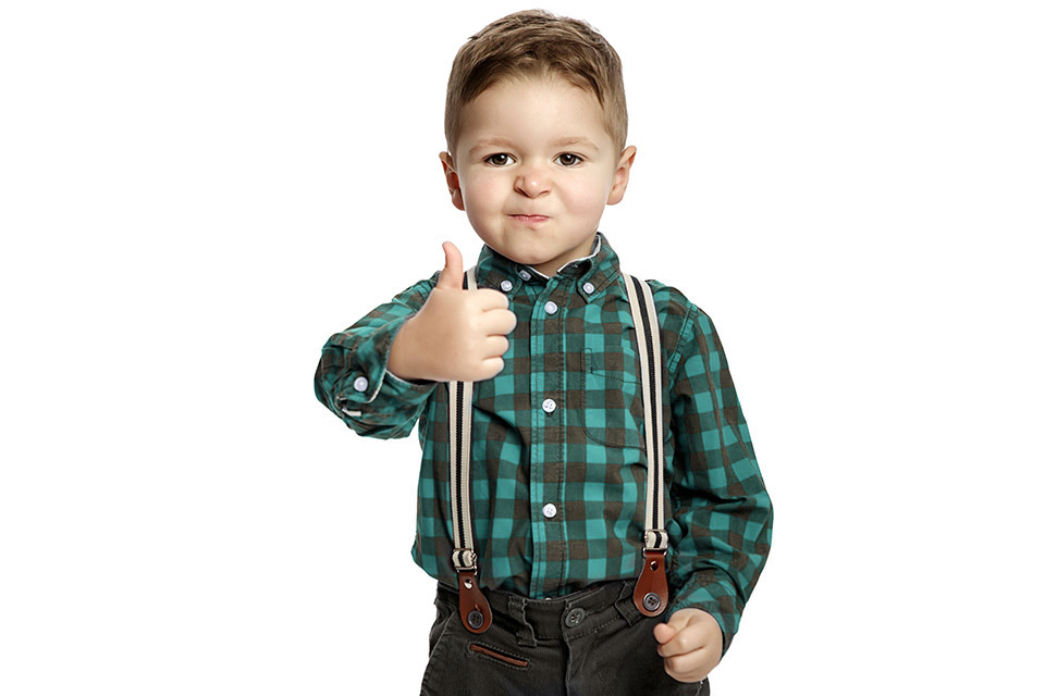 Kid with thumb up - image